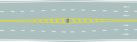 What is the meaning of the yellow filled marking on the road?