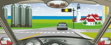 When driving a motorized vehicle at such an intersection what do the traffic lights mean?